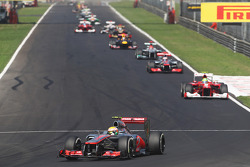 Lewis Hamilton, McLaren leads at the end of the opening lap of the race