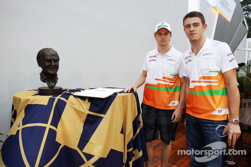 Nico Hulkenberg, Sahara Force India F1 with team mate Paul di Resta, Sahara Force India F1 sign the book of condolences for the late Sid Watkins, Former FIA Safety Delegate