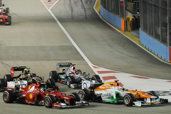 Paul di Resta, Sahara Force India and Fernando Alonso, Ferrari at the start of the race lead Nico Rosberg, Mercedes AMG F1