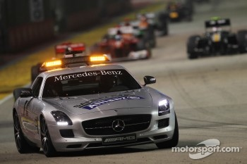 Sebastian Vettel, Red Bull Racing leads behind the Safety Car