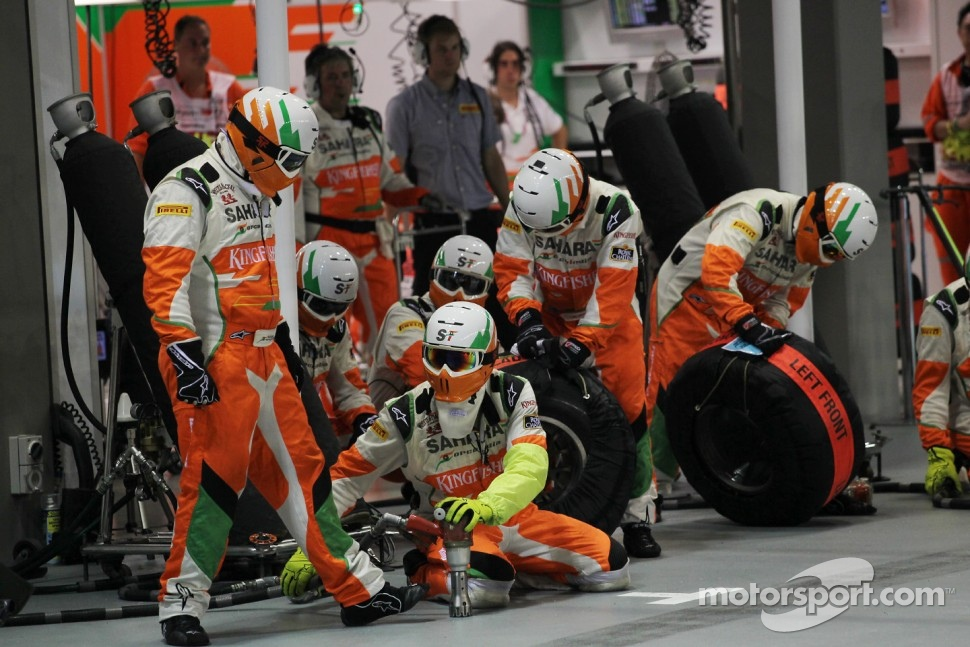 Sahara Force India F1 Team mechanics await a pit stop