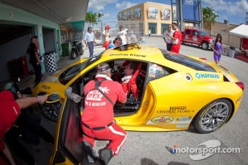 #23 Ferrari of Central Florida 458TP: Onofrio Triarsi in bad shape after a collision with #68 Ferrari of San Francisco 458CS: Mike Hedlund