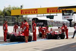 Felipe Massa, Ferrari and team mate Fernando Alonso, Ferrari in the pits