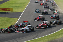 Fernando Alonso, Ferrari and Kimi Raikkonen, Lotus F1 make contact at the start of the race