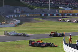 Nico Rosberg, Mercedes AMG F1 crashes out at the start of the race and Mark Webber, Red Bull Racing runs off the track