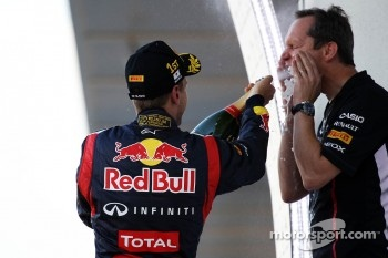 Race winner Sebastian Vettel, Red Bull Racing celebrates on the podium with Paul Monaghan, Red Bull Racing Chief Engineer