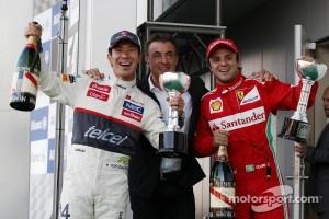 Kamui Kobayashi, Sauber celebrates his third position on the podium with Jean Alesi, and second placed Felipe Massa, Ferrari