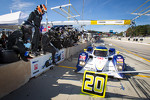Pit stop for #20 Dyson Racing Team Lola B11/66 Mazda: Tony Burgess, Mark Patterson, Chris McMurry