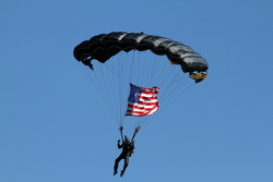 Parachuter over pre-race grid