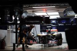 Scuderia Toro Rosso STR7 in the pit garage at night