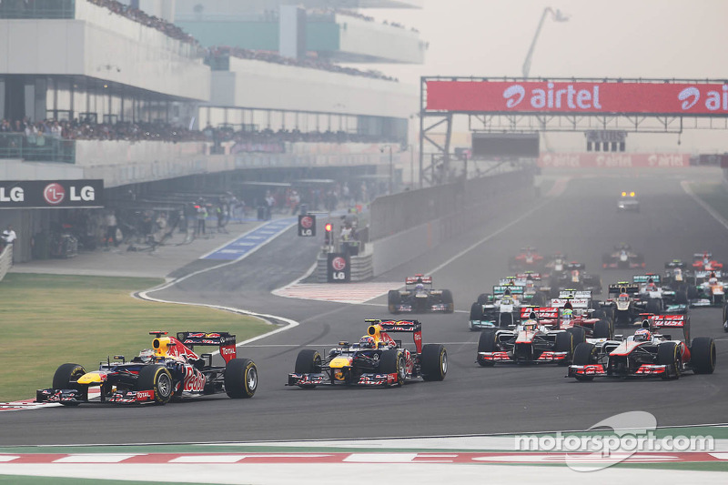 Sebastian Vettel, Red Bull Racing leads team mate Mark Webber, Red Bull Racing at the start of the race