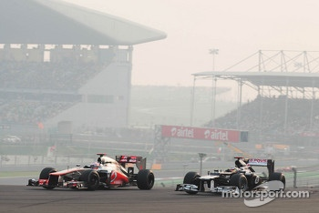 Jenson Button, McLaren and Pastor Maldonado, Williams battle for position