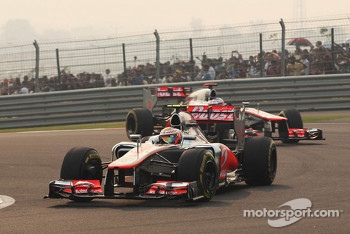 Lewis Hamilton, McLaren leads team mate Jenson Button, McLaren