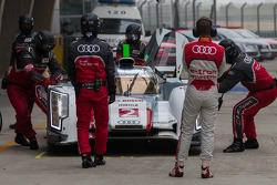 Allan McNish watching the #2 Audi e-tron quattro going into the garage