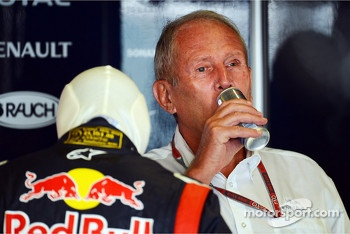 Dr Helmut Marko, Red Bull Motorsport Consultant enjoys a Red Bull