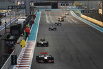 Lewis Hamilton, McLaren leads at the start of lap two