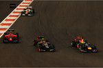 Sebastian Vettel, Red Bull Racing battles with Romain Grosjean, Lotus F1 and Charles Pic, Marussia F1 Team