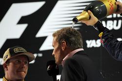 David Coulthard, Red Bull Racing and Scuderia Toro Advisor / BBC Television Commentator with Kimi Raikkonen, Lotus F1 Team on the podium