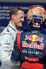 Polesitter Sebastian Vettel, Red Bull Racing celebrates with Michael Schumacher, Mercedes AMG F1