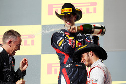 Race winner Lewis Hamilton, McLaren celebrates on the podium with Martin Whitmarsh, McLaren Chief Executive Officer and Sebastian Vettel, Red Bull Racing