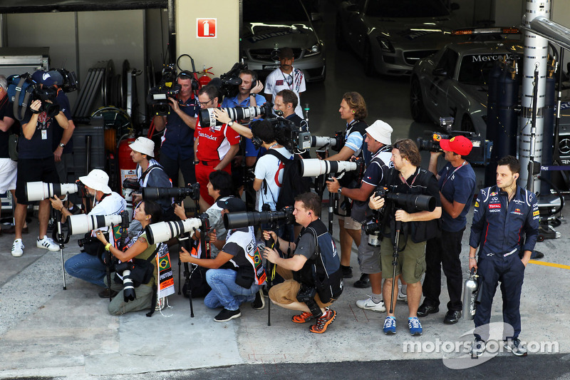 Photographers in the pit lane and Stefano Domenicali, Ferrari General Director