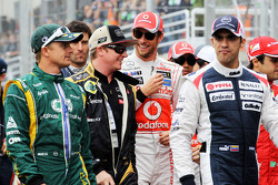 Heikki Kovalainen, Caterham, Kimi Raikkonen, Lotus F1 Team, Jenson Button, McLaren, Pastor Maldonado, Williams on the drivers parade