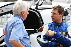 Charlie Whiting, FIA Delegate with Bernd Maylander, FIA Safety Car Driver on the grid