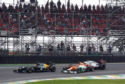Nico Hulkenberg, Sahara Force India F1 and Lewis Hamilton, McLaren crash battling for the lead of the race