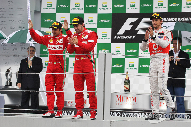Felipe Massa, Ferrari and Fernando Alonso, Ferrari celebrate on the podium with race winner Jenson Button, McLaren