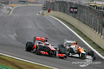 Jenson Button, McLaren Mercedes and Nico Hulkenberg, Sahara Force India Formula One Team