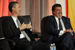 President and CEO of Grand American Road Racing, Ed Bennett and NASCAR President Mike Helton speak onstage at the NASCAR Motorsports Forum