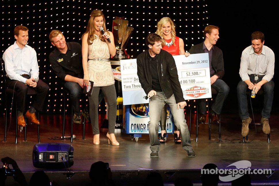 Fellow drivers laugh as Denny Hamlin dances on stage