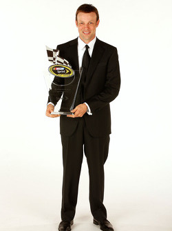 Matt Kenseth with the seventh place trophy