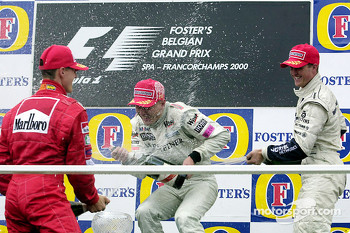 Podium: race winner Mika Hakkinen, second place Michael Schumacher, third place Ralf Schumacher