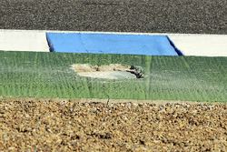 A hole formed at the exit of turns 9 and ten which caused testing to be temporarily halted