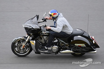 Travis Pastrana rides his motorcycle on Daytona International Speedway