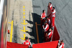 Red screens erected by Ferrari in the pits