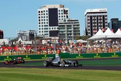 Lewis Hamilton, Mercedes AMG F1 W04 leads Sergio Perez, McLaren MP4-28