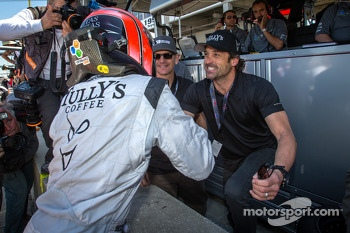 GTC pole winner Andy Lally celebrates with Patrick Dempsey