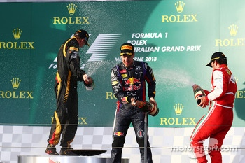 (L to R): Race winner Kimi Raikkonen, Lotus F1 Team celebrates with Sebastian Vettel, Red Bull Racing and Fernando Alonso, Ferrari on the podium