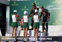 The podium, Ferrari, second; Jenson Button, McLaren, race winner; Fernando Alonso, Ferrari, third, presented with caps by the Rolex girls