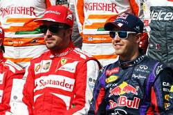 (L to R): Fernando Alonso, Ferrari and Sebastian Vettel, Red Bull Racing at the start of year drivers photo