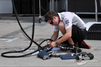 McLaren mechanic with an air gun