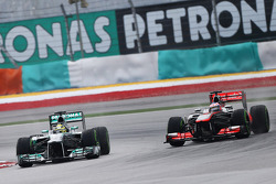 Nico Rosberg, Mercedes AMG F1 W04 and Jenson Button, McLaren MP4-28 battle for position