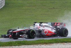 Jenson Button, McLaren MP4-28 and Nico Rosberg, Mercedes AMG F1 W04 battle for position