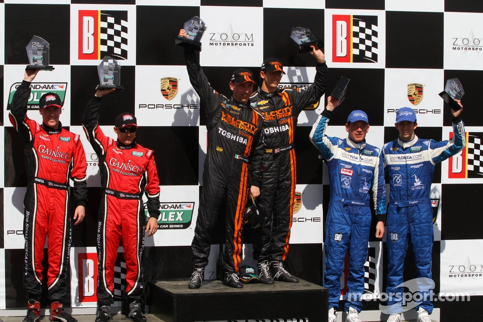 Victory lane: race winners Max Angelelli and Jordan Taylor, second place Alex Gurney and Jon Fogarty, third place Richard Westbrook and Ricky Taylor