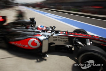 Jenson Button, McLaren MP4-28 leaves the pits