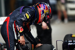 Sebastian Vettel, Red Bull Racing RB9 checks the medium Pirelli tyre that he locked up on his final qualifying lap in parc ferme