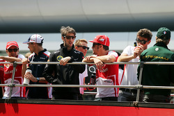 Romain Grosjean, Lotus F1 Team and Fernando Alonso, Ferrari on the drivers parade