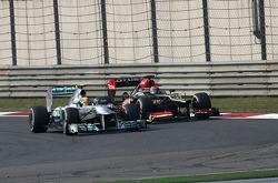 Lewis Hamilton, Mercedes Grand Prix and Kimi Raikkonen, Lotus F1 Team